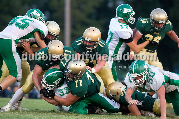 Erica Lafser/The Herald Forest Parks Eli Knust and Mickevin Wilson brought down Perry Central's Jacob Braun with the ball during Friday night's game in Ferdinand. The Rangers lost 21-26.