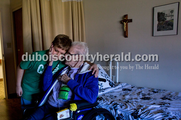 """Dakota Roach of Crystal, 11, gave Northwood Retirement Community resident Katie LaRue a hug after helping LaRue to her room April 4 at the Jasper facility. LaRue is one of the residents Dakota always visits when he volunteers. """"He's a nice kid,"""" LaRue said. """"He does a lot around here."""""""