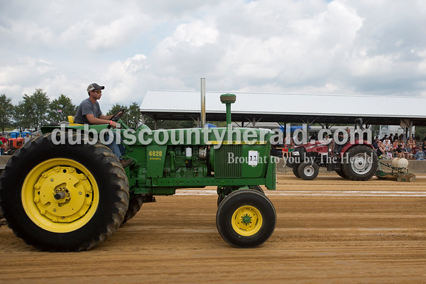 Erica Lafser/The Herald Max Hasenour of Celestine, 17, attempted a pull during the Celestine Volunteer Fire Department's annual tractor pull on Sunday at the Celestine Community Club in Celestine.