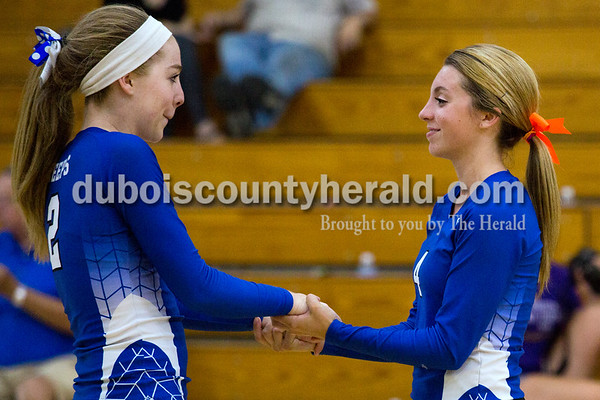 Northeast Dubois' Clare Mangin and Kennedy Neukam shared a moment at at the beginning of the second set in Thursday's 25-16, 22-25, 25-12, 25-15 loss to North Knox at the Northeast Dubois gym.  Alisha Jucevic/The Herald