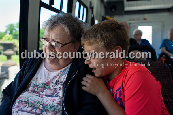 """Dakota, right, chatted with resident Ann Fisher as they looked out the window on their ride to Los Bravos in Jasper for a lunch outing June 10. Dakota talks fondly of Fisher. """"She was a teacher, so she loves kids,"""" he said."""