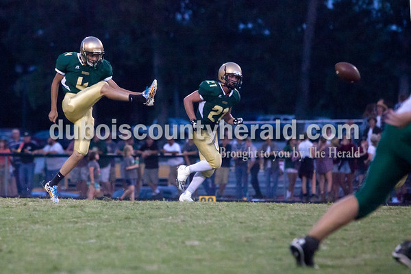 Erica Lafser/The Herald Forest Park's Blake Mohr punted the ball during Friday night's game in Ferdinand. The Rangers lost 21-26.