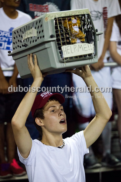 Southridge High School junior Chase Stetter held up a cat kennel during Friday night's game at Jerry Brewer Alumni Stadium in Jasper. The Wildcats defeated the Raiders 18-13.  Alisha Jucevic/The Herald