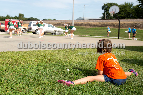 Erica Lafser/The Herald Kendall King of St. Meinrad, 9, did the splits as she watched her cousin on the Forest Park high school dance team practice before performing during Birdseye Picnic on Saturday at Birdseye Park.