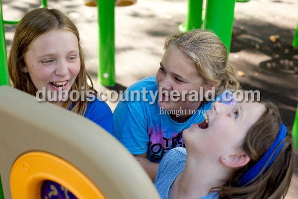 Ariana van den Akker/The Herald On Wednesday evening, members of the St. Celestine and St. Raphael junior high and high school youth groups flocked to the Dubois Community Park in Dubois for a cookout to start the new school year. Elizabeth Schepers, left, Gianna Wagner and Kendall Buechler, all 10 and of Celestine, reacted to the answer of a magic eight ball-like device on the playground during the event.