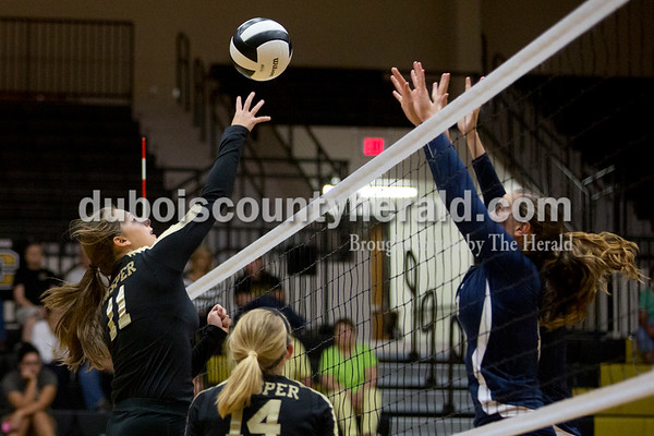Jasper's Jocelynn Morrow pushed the ball over the net as Heritage Hills' Abby Wahl blocked during Tuesday night's game in Jasper. The Wildcats won in three sets. Ariana van den Akker/The Herald