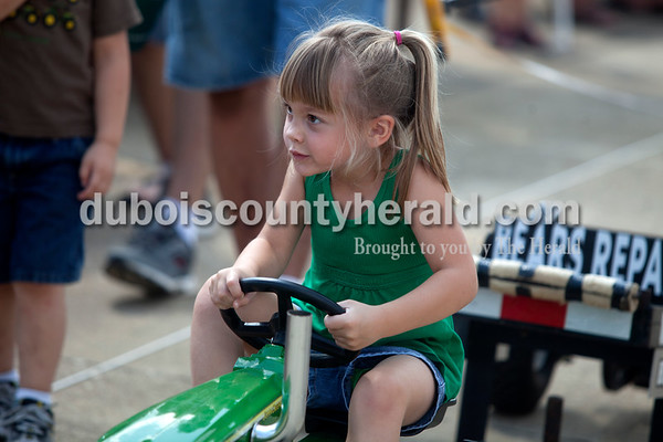 Erica Lafser/The Herald Makenzie Beyke of Celestine, 4, was the first participant in the kiddie tractor pull at the Celestine Volunteer Fire Department's annual tractor pull on Sunday at the Celestine Community Club in Celestine.