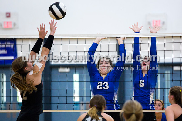 Northeast Dubois' Elizabeth Huebner and Kortney Quinn jumped in the air to block North Knox's Makinzi Meurer's pop over the net in Thursday's match at the Northeast Dubois gym. Northeast Dubois lost to North Knox 25-16, 22-25, 25-12, 25-15.  Alisha Jucevic/The Herald