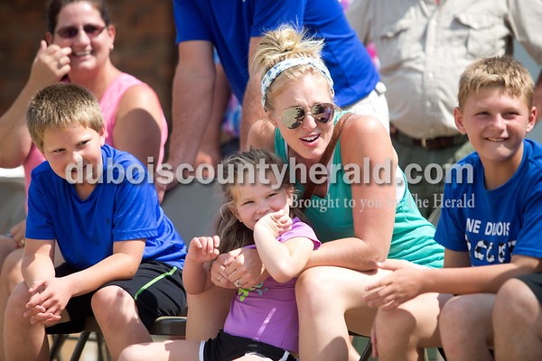 Erica Lafser/The Herald Jennifer Lampert of Jasper, left, sat with her son Caleb, 8, daughter Lexi, 5, niece Erica Verkamp, and nephew Gavin Leinenbach, 10, all of Jasper, as they watched her other nephew and all of theirs cousin, Symon Lampert of Jasper, 4, pull during the kiddie tractor pull at the Celestine Volunteer Fire Department's annual tractor pull on Sunday at the Celestine Community Club in Celestine.