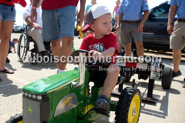 Erica Lafser/The Herald Leo Seger of Celestine, 2, participated in his first kiddie tractor pull at the Celestine Volunteer Fire Department's annual tractor pull on Sunday at the Celestine Community Club in Celestine.