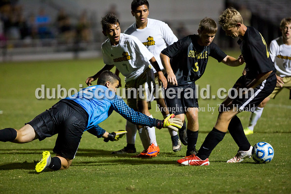 Jasper's Josue Dubon and Fernando Garcia scrambled for the ball against Boonville's goalie Blake Swan and Boonville's Jacob Winge and Tanner Cundiff during Monday night's game in Jasper. The Wildcats won 4-0. Alisha Jucevic/The Herald