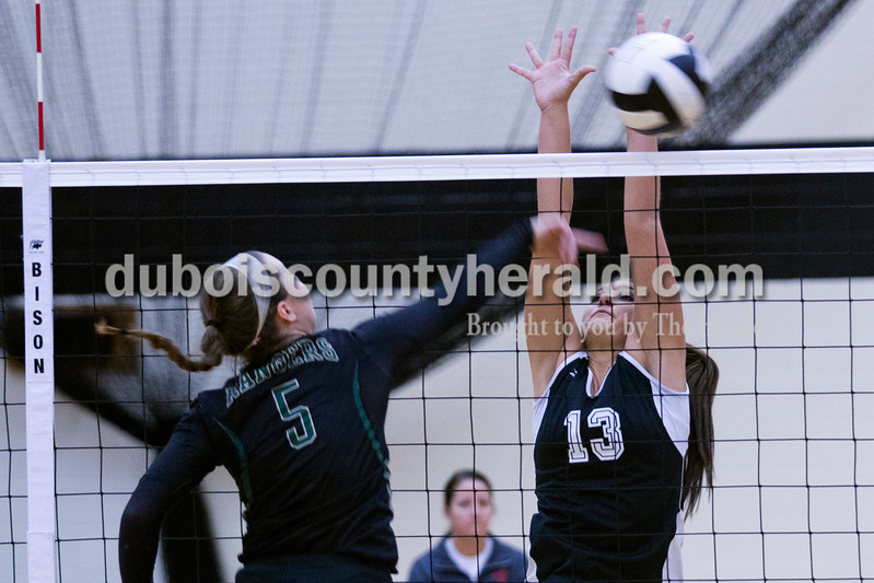 Forest Park's Madi Giesler spiked the ball over the net as Southridge's Kassidy Mundy jumped up to block during Monday night's match at Southridge High School in Huntingburg. The Raiders defeated the Rangers in three sets. <br /> Alisha Jucevic/The Herald