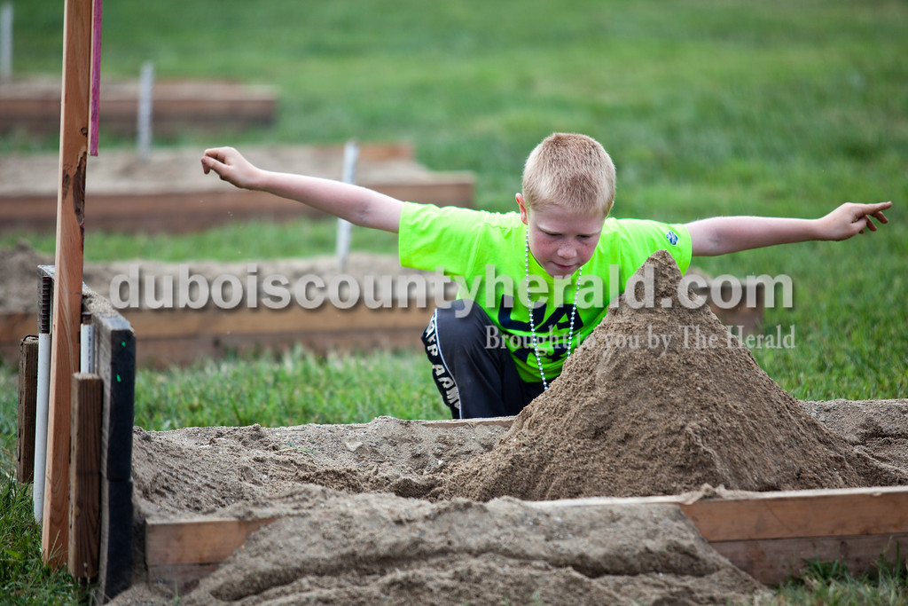 Alisha Jucevic/The Herald<br /> <br /> Jaxson Graman of Vincennes, 10, played with the sand in a horse shoe pit on Saturday afternoon at the Dale Fall Festival.