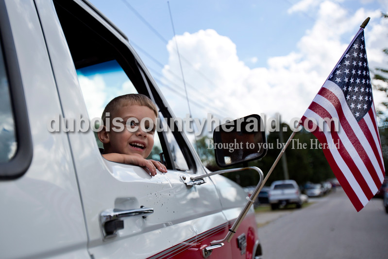 Alisha Jucevic/The Herald<br /> <br /> Ryker Cross of Rockport, 3, looked out at the crowded streets of Dale during the end of the parade on Saturday afternoon at the Dale Fall Festival.