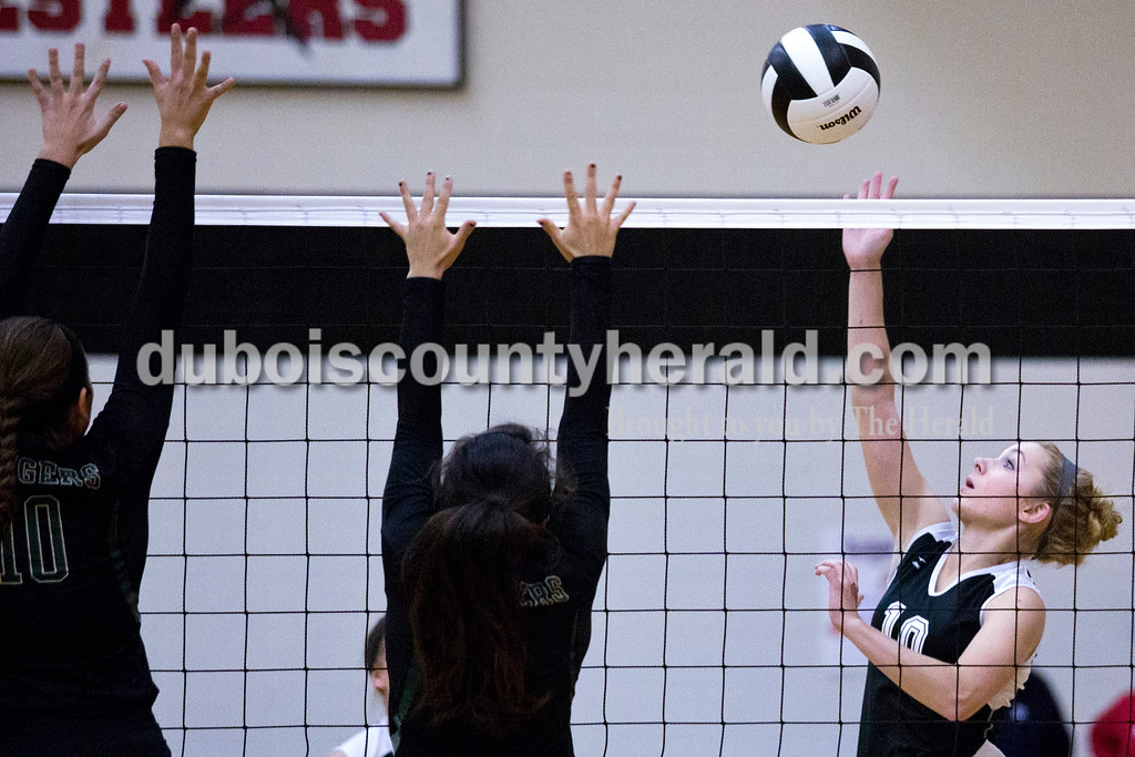 Southridge's Taylor Neukam sent the ball over the net as Forest Park's Karissa Wollenmann, left, and Katelyn Tretter, center, blocked during Monday night's match at Southridge High School in Huntingburg. The Raiders defeated the Rangers in three sets. <br /> Alisha Jucevic/The Herald