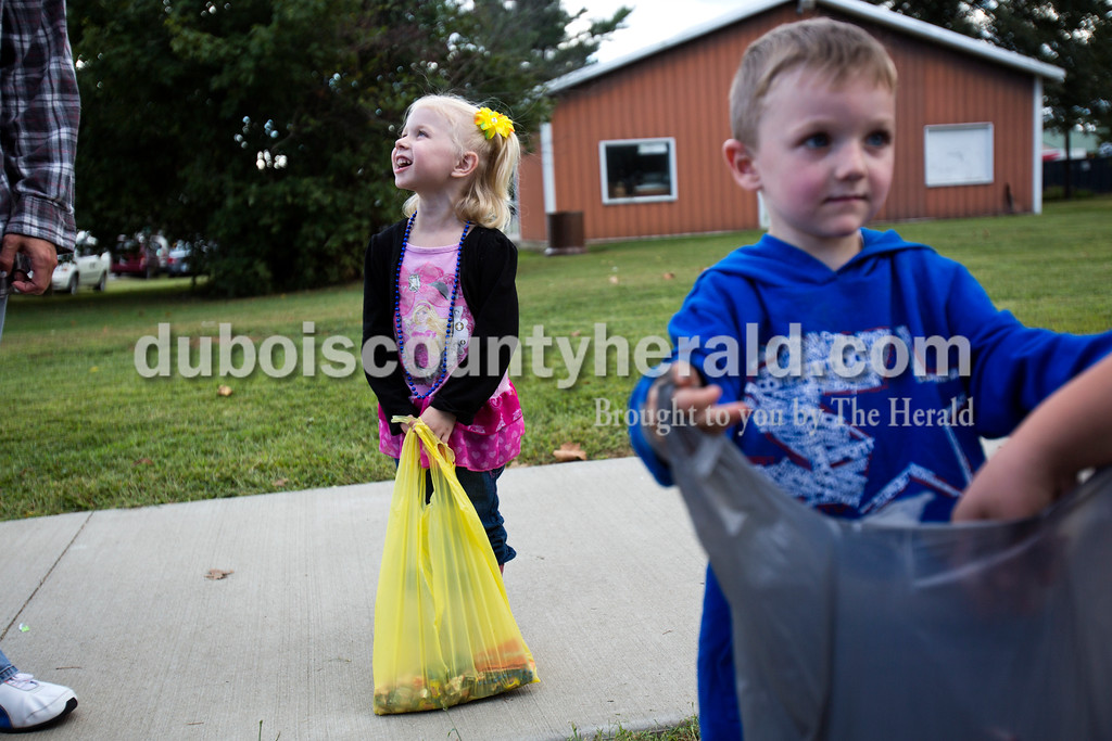 Alisha Jucevic/The Herald<br /> <br /> Kaydence Hobert of Evansville, 3, left, and her cousin Ayden Cloe of Indianapolis, 4, collected candy during the parade on Saturday afternoon at the Dale Fall Festival.