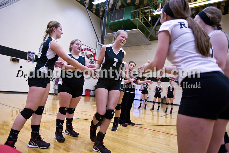 Southridge's Kenzie Lubbehusen high-fived her teammates during introductions before Monday night's match against Forest Park at Southridge High School in Huntingburg. The Raiders defeated the Rangers in three sets. <br /> Alisha Jucevic/The Herald