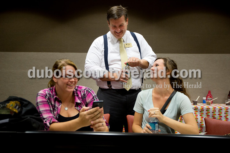 Christopher Gray, the new assistant vice president and dean of Vincennes University Jasper Campus, joked with nursing students Mackenzie Bender of Winslow, left, and Jessica Young of Evanston about Bender's cell phone during an ice cream social on Wednesday at the Jasper Campus Classroom Building on the VUJC campus in Jasper.