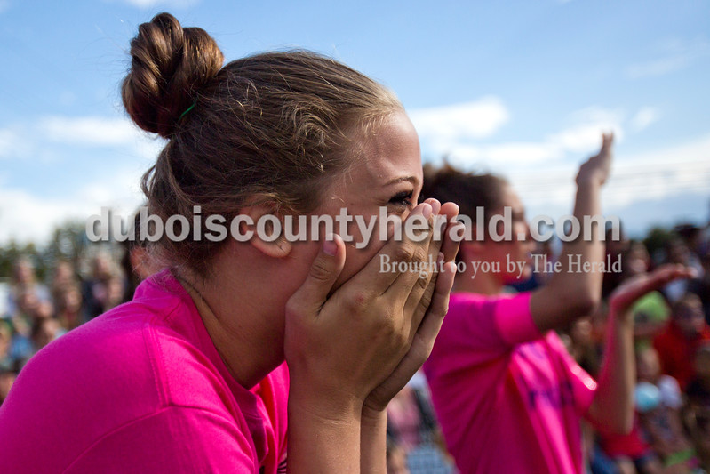 Alisha Jucevic/The Herald<br /> <br /> 2015 Dale Fall Fest Queen Hope Davis of Dale, 17, reacts as her team's hog is released into the pit before the hog wrestling competition Saturday at Dale Fall Festival.
