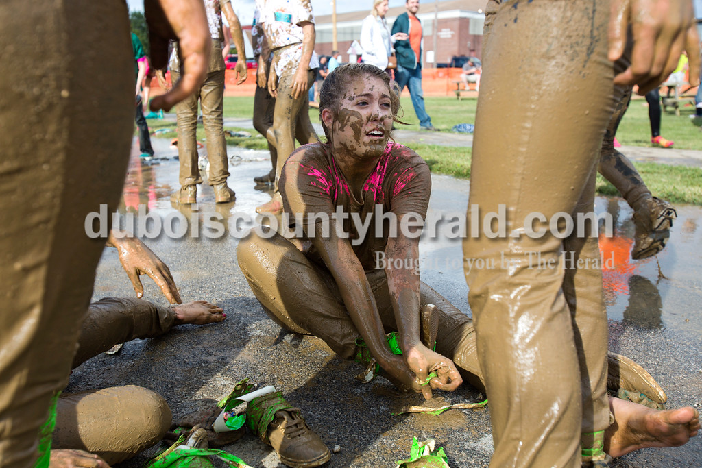Alisha Jucevic/The Herald<br /> <br /> Gabbie Ginanni of Santa Claus, 14, pulled the Duct Tape off her jeans after competing in the Dale Fall Festival's annual hog wrestling contest Saturday.