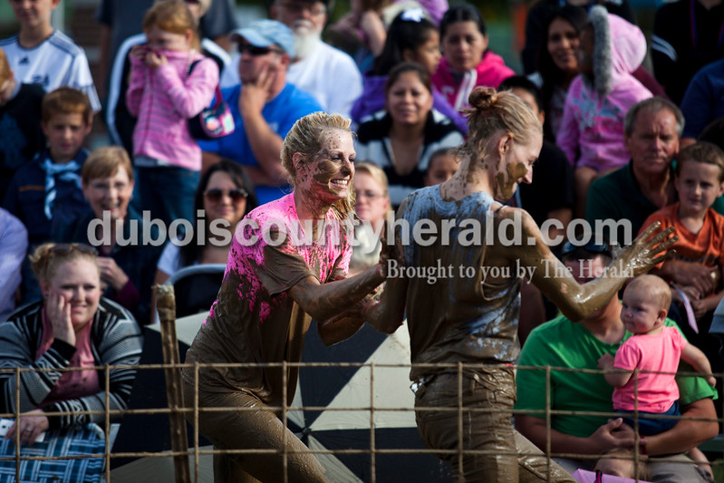 Alisha Jucevic/The Herald<br /> <br /> Cheyenne Whipking of Jasper and Cindy Hobert of Evansville spread mud on each other after competing in the Dale Fall Festival's annual hog wrestling contest Saturday.