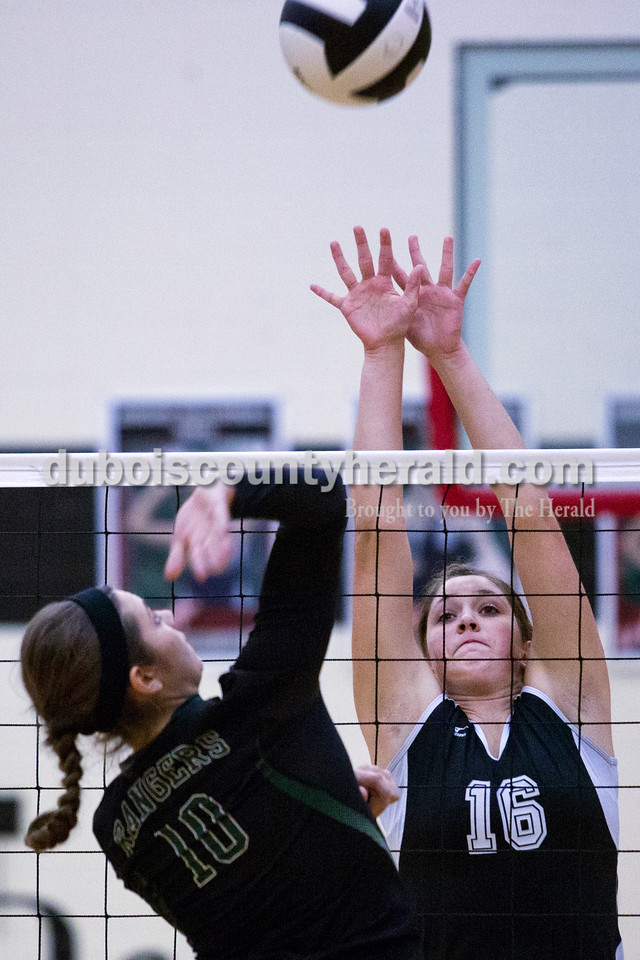 Forest Park's Karissa Wollenmann prepared for a spike as Southridge's Sydney Altmeyer jumped to block during Monday night's match against at Southridge High School in Huntingburg. The Raiders defeated the Rangers in three sets. <br /> Alisha Jucevic/The Herald