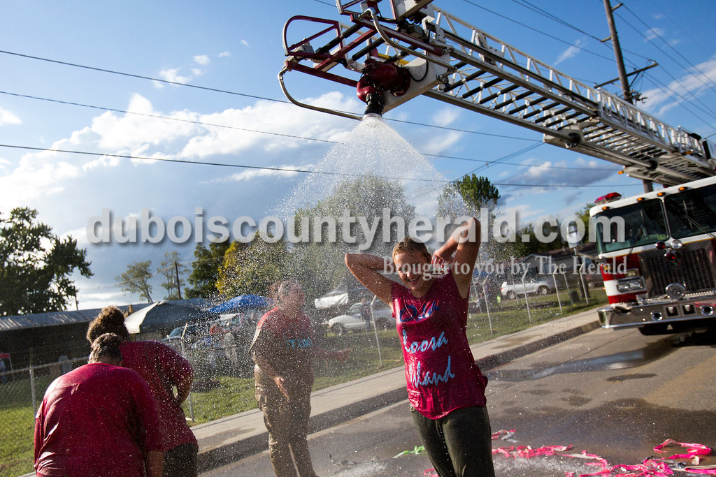 Alisha Jucevic/The Herald<br /> <br /> Cassi Beier of Mariah Hill, 13,  showered off after hog wrestling on Saturday at the Dale Fall Festival.