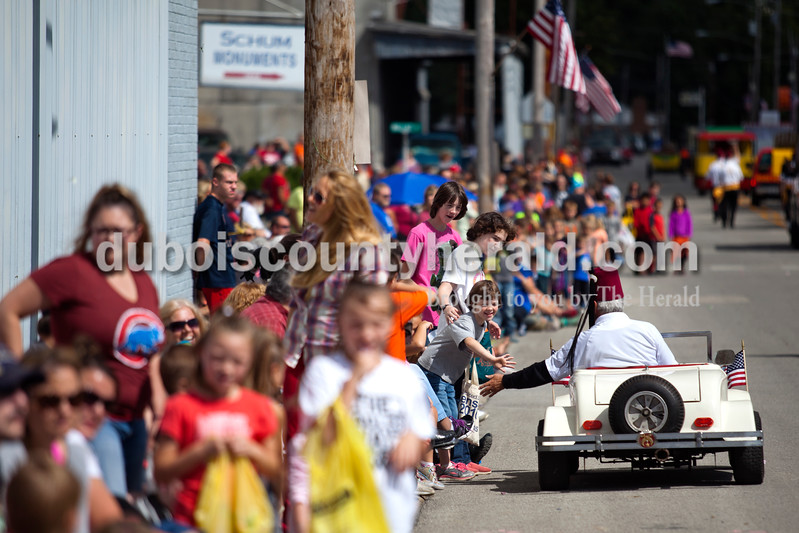 Alisha Jucevic/The Herald<br /> <br /> Crystal Auffart of St. Meinrad reached out to high five a member of the Dubois County Roadsters during the parade on Saturday afternoon at the Dale Fall Festival.