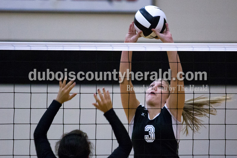 Southridge's Kayla Voegerl tapped the ball over the net as Forest Park's Katelyn Tretter jumped up to block during Monday night's match  at Southridge High School. The Raiders defeated the Rangers in three sets. <br /> Alisha Jucevic/The Herald
