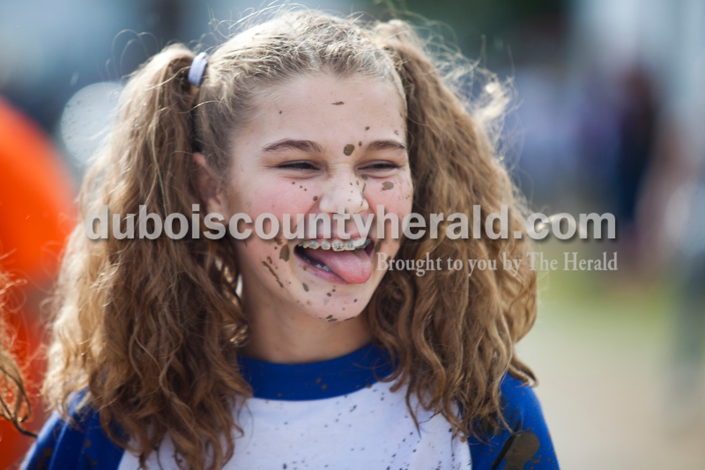Alisha Jucevic/The Herald<br /> <br /> Hannah Marchand of Dale, 13, made a face at her friend after competing in the Dale Fall Festival's annual hog wrestling contest Saturday.