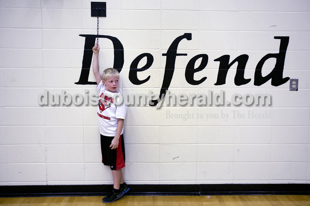 Raider fan Jackson Buse of Huntingburg, 7, watched the crowd leave the gym after Monday night's match against Forest Park at Southridge High School in Huntingburg. The Raiders defeated the Rangers in three sets. <br /> Alisha Jucevic/The Herald