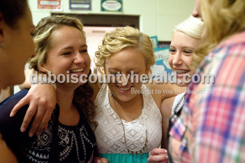 Erica Lafser/The Herald<br /> Natalie Jacob, 18, center, pulled in Haley Hoffman, 18, left, and Paige Leonard, 14, all of Schnellville, for a hug before their competition for queen at the Schnellville Sesquicentennial queen pageant on Saturday at Pine Ridge Elementary in Birdseye.