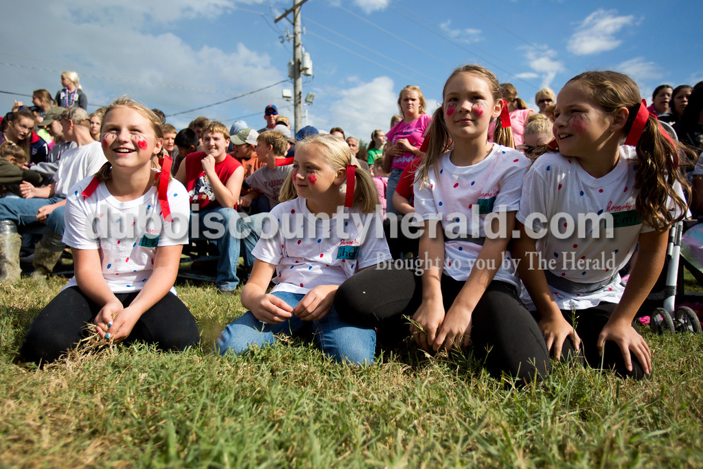 """Alisha Jucevic/The Herald<br /> <br /> Alexa Fleck of Dale, 10, Chelsey Tempel of Ferdinand, 11, Madison Wagner of Santa Claus, 10, and Emma Carpenter of Santa Claus, 10, waited for the hog wrestling event to begin Saturday at the Dale Fall Festival. """"You have to grab the pig and don't be bashful,"""" Fleck said."""