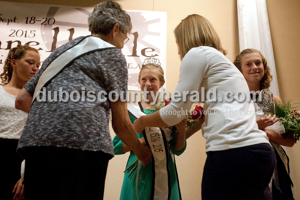 Erica Lafser/The Herald<br /> Claire Eckert recieved her sash, flowers and trophy after winning the junior miss portion of the Schnellville Sesquicentennial queen pageant on Saturday at Pine Ridge Elementary in Birdseye.