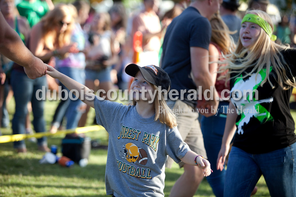 Erica Lafser/The Herald<br /> Marissa Bolden of Birdseye, 7, danced with her new friend, Brandon Hopf of St. Anthony, during a performance by the Way Down Wanderers at the Ferdinand Folk Festival on Saturday at 18th Street Park in Ferdinand.