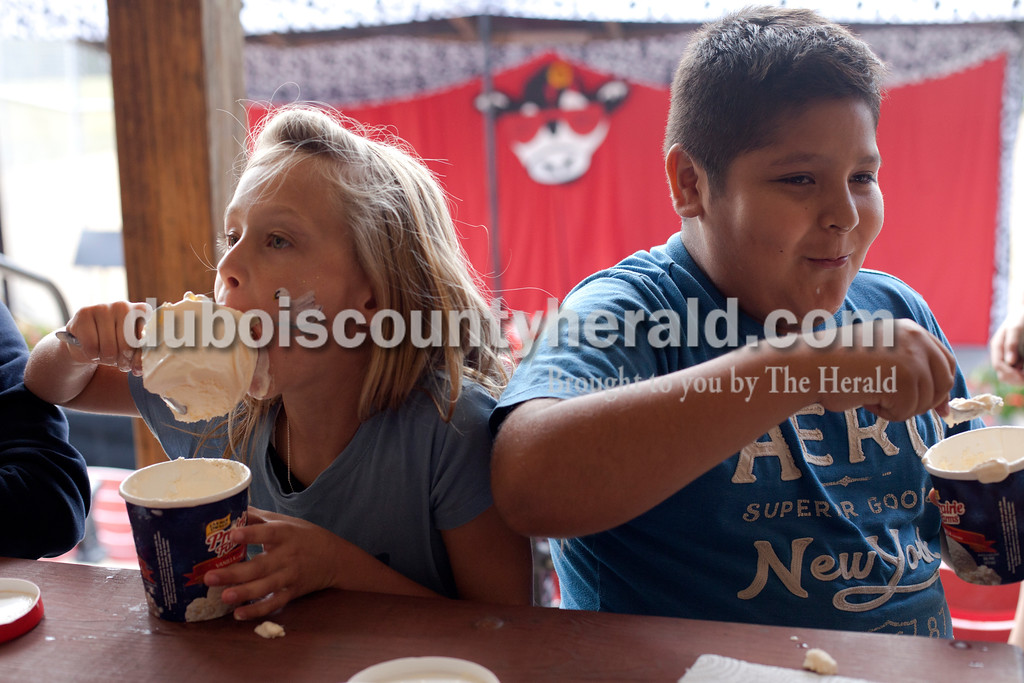 Erica Lafser/The Herald<br /> Heather Schoenbachler, 9, left, and Eric Vanegas, 12, both of Huntingburg, competed in the first annual ice cream eating contest held during the Holland Community Fest on Saturday at Holland Park in Holland.