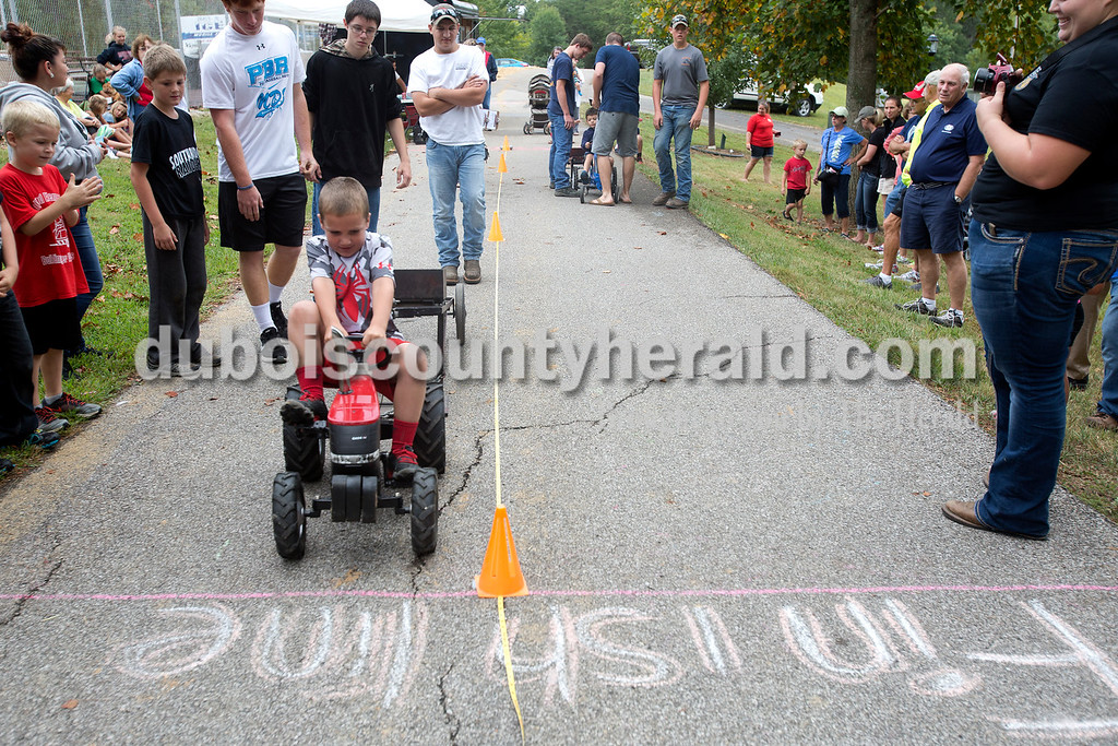 Erica Lafser/The Herald<br /> Max Hentrum of Holland, 6, finished the kids tractor pull inches away from the finish line during the Holland Community Fest on Saturday at Holland Park in Holland.