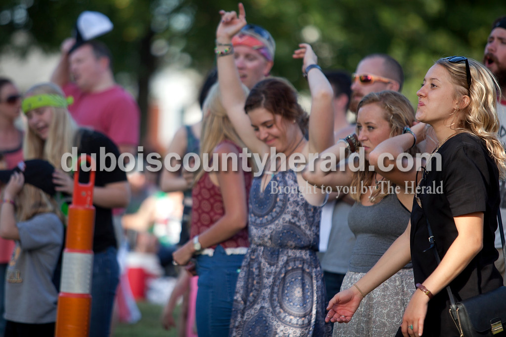 Erica Lafser/The Herald<br /> Shelby Klem of Ferdinand, left, danced with her friends Hailei Gehlhausen of Schnellville and Cassie Dilger of Ferdinand during the Ferdinand Folk Festival on Saturday at 18th Street Park in Ferdinand.