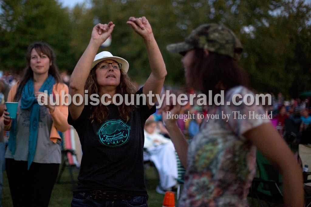 Erica Lafser/The Herald<br /> Cheryl Meyer of Huntingburg danced to music performed onstage at the Ferdinand Folk Festival on Saturday at 18th Street Park in Ferdinand.