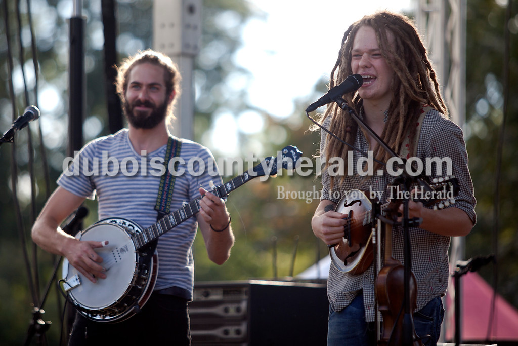 Erica Lafser/The Herald<br /> Ben Montalbano, left, and Collin Krause performed as part of the Way Down Wanderers in the Ferdinand Folk Festival on Saturday at 18th Street Park in Ferdinand.