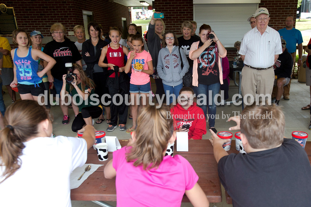 Erica Lafser/The Herald<br /> Luxey Neukam of Huntingburg, 13, left, Adi Luker of Holland, 11, and Skyler Gifford of Holland, 11, competed in the first annual ice cream eating contest held during the Holland Community Fest on Saturday at Holland Park in Holland.