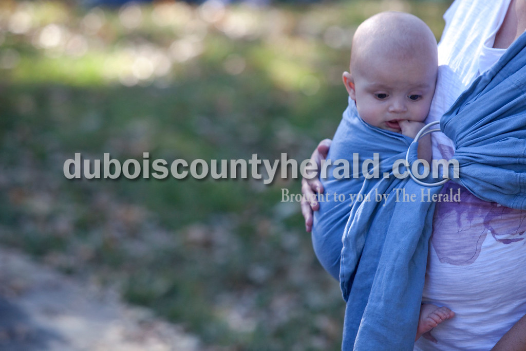 Erica Lafser/The Herald<br /> 5-month-old Edward Heal of Birdseye rested against his mom, Tina during the Ferdinand Folk Festival on Saturday at 18th Street Park in Ferdinand.