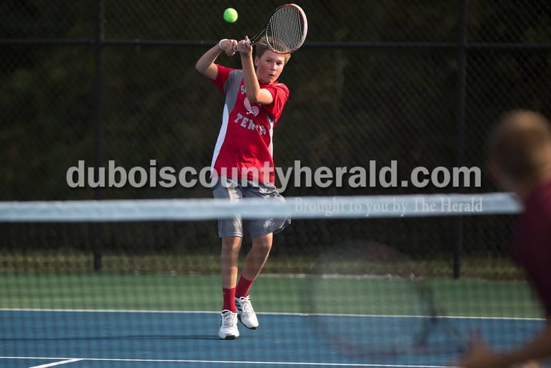 Southridge's Carson Mundy kept his eye on the ball during Wednesday's tennis sectional against Pike Central in Jasper. Ariana van den Akker/The Herald