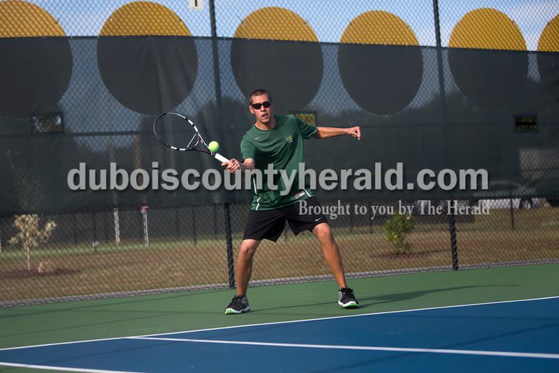 Forest Park's Matthew Nonte returned the ball during Wednesday's tennis sectional against Jasper in Jasper. Ariana van den Akker/The Herald