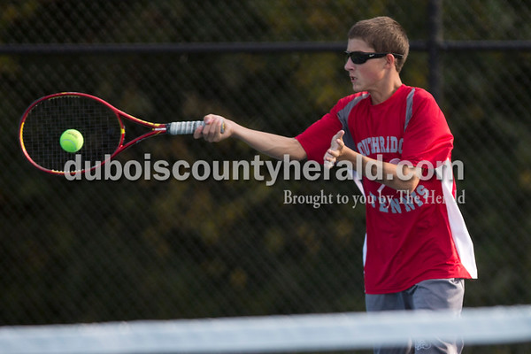 Southridge's Logan Welp returned the ball during Wednesday's tennis sectional against Pike Central in Jasper. Ariana van den Akker/The Herald