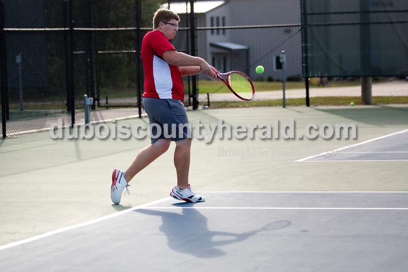 Southridge's Luke Taylor returned a serve during Wednesday's tennis sectional against Pike Central in Jasper. Ariana van den Akker/The Herald