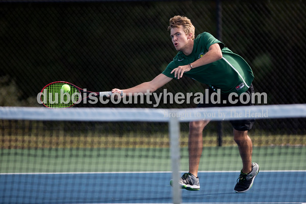 Forest Park's Aaron Meyer returned the ball during Wednesday's tennis sectional against Jasper in Jasper. Ariana van den Akker/The Herald