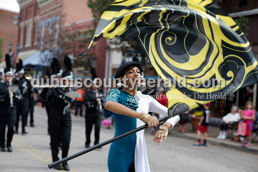 Erica Lafser/The Herald<br /> Kimberly Martin of Huntingburg, 14, led the Southridge Raider Band alongside other members of the color guard during the Herbstfest parade on Sunday in Huntingburg.