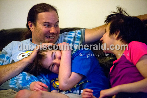 "Sean played with Alex's hair and smiled at Zoe as they watched TV together on June 2 at their home in Mariah Hill. ""Zoe depends on people's facial expressions,"" Kasie Appel said. ""She pays attention to the mood of people and their expressions."""