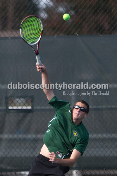 Forest Park's David Lusk served during Wednesday's tennis sectional against Jasper in Jasper. Ariana van den Akker/The Herald